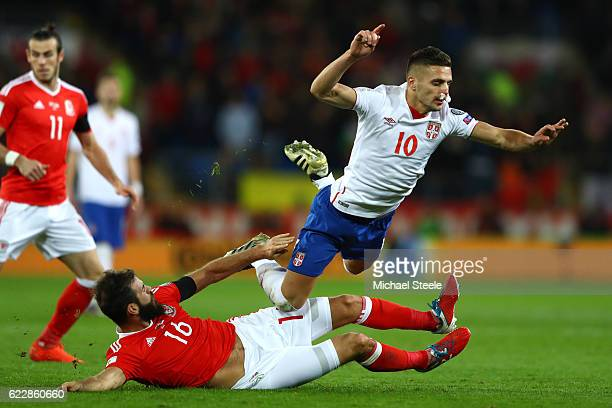 Dusan Tadic of Serbia is challenged by Joe Ledley of Wales during the FIFA 2018 World Cup Qualifier between Wales and Serbia at Cardiff City Stadium...