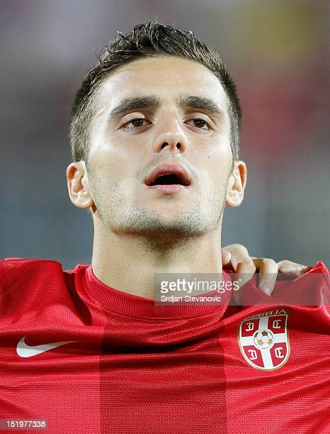 Dusan Tadic of Serbia listens to the national anthem prior to the FIFA 2014 World Cup Qualifier at stadium Karadjordje Park between Serbia and Wales...