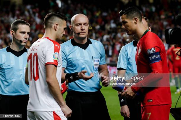 Dusan Tadic of Serbia referee Szymon Marciniak Cristiano Ronaldo of Portugal during the EURO Qualifier match between Portugal v Serbia at the Estádio...