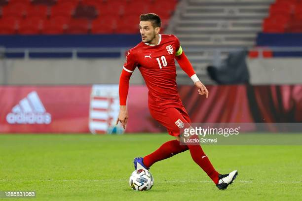 Dusan Tadic of Serbia runs with the ball during the UEFA Nations League group stage match between Hungary and Serbia at Puskas Arena on November 15,...