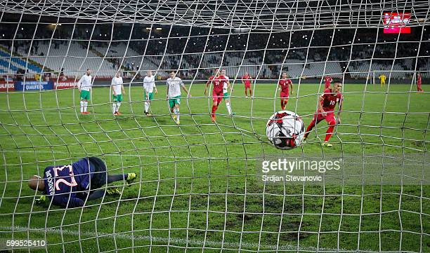 Dusan Tadic of Serbia scores the goal from penalty near goalkeeper Darren Randolph of Ireland during the FIFA 2018 World Cup Qualifier between Serbia...