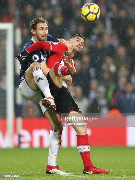 Dusan Tadic of Southampton and Craig Dawson of West Bromwich Albion during the Premier League match between West Bromwich Albion and Southampton at...