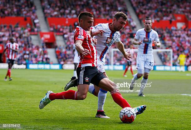 Dusan Tadic of Southampton and James McArthur of Crystal Palace compete for the ball during the Barclays Premier League match between Southampton and...