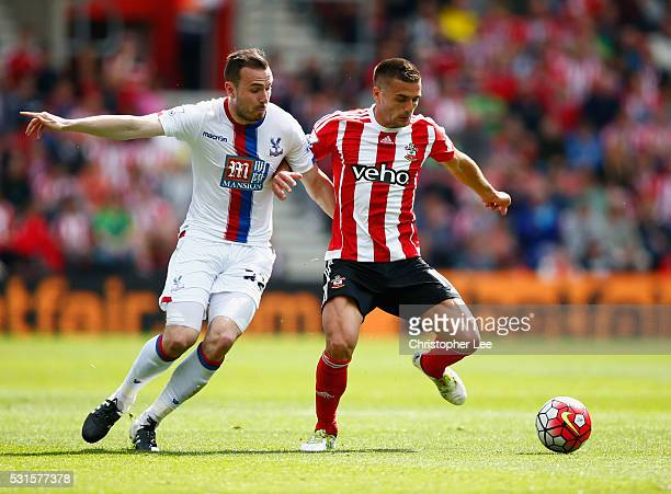 Dusan Tadic of Southampton and Jordon Mutch of Crystal Palace compete for the ball during the Barclays Premier League match between Southampton and...