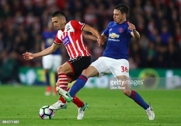 Dusan Tadic of Southampton and Matteo Darmian of Manchester United battle for possession during the Premier League match between Southampton and...
