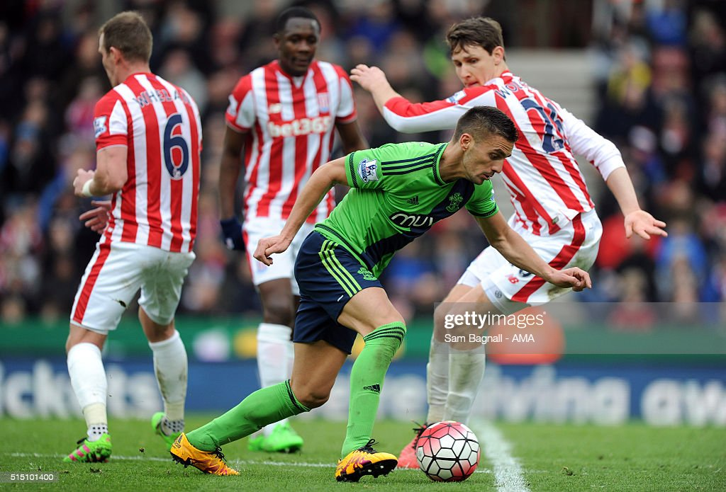 Dusan Tadic of Southampton and Philipp Wollscheid of Stoke City during the Barclays Premier League match between Stoke City and Southampton at Britannia Stadium on March 12, 2016 in Stoke on Trent, England.