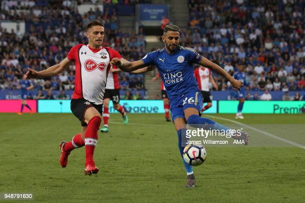 Dusan Tadic of Southampton and Riyad Mahrez of Leicester City during the Premier League match between Leicester City and Southampton at The King...