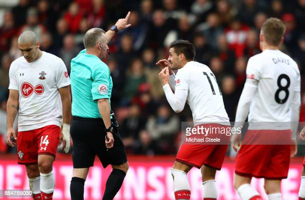 Dusan Tadic of Southampton appeals to the referee Jonathan Moss during the Premier League match between AFC Bournemouth and Southampton at Vitality...