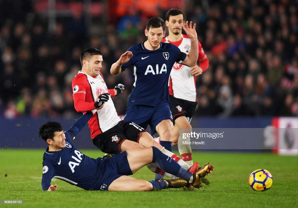 Dusan Tadic of Southampton battles with Heung-Min Son and Jan Vertonghen of Tottenham Hotspur during the Premier League match between Southampton and Tottenham Hotspur at St Mary's Stadium on January 21, 2018 in Southampton, England.
