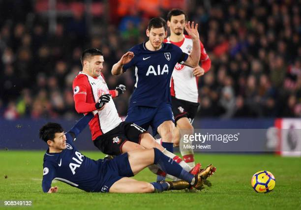 Dusan Tadic of Southampton battles with HeungMin Son and Jan Vertonghen of Tottenham Hotspur during the Premier League match between Southampton and...