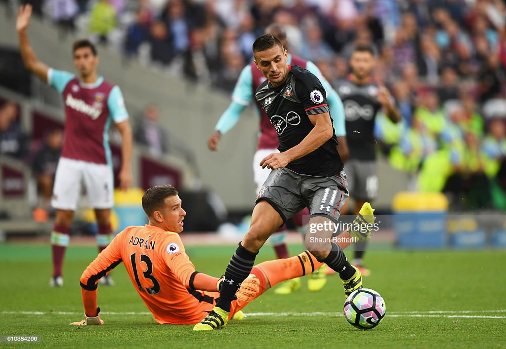 Dusan Tadic of Southampton (11) beats Adrian of West Ham United as he scores their second goal during the Premier League match between West Ham United and Southampton at London Stadium on September 25, 2016 in London, England.