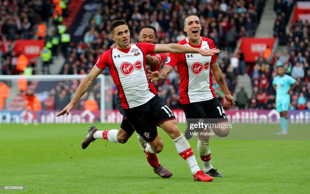 Dusan Tadic(L) of Southampton celebrates after scoring his second to make it 2-1 to Southampton during the Premier League match between Southampton and AFC Bournemouth at St Mary's Stadium on April 28, 2018 in Southampton, England.