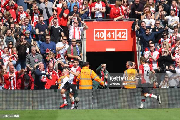 Dusan Tadic of Southampton celebrates after scoring his sides first goal during the Premier League match between Southampton and Chelsea at St Mary's...