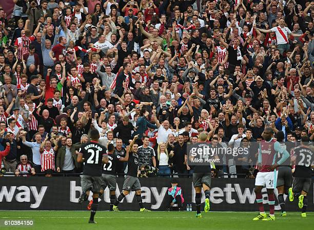 Dusan Tadic of Southampton celebrates in front of jubilant fans as he scores their second goal during the Premier League match between West Ham...