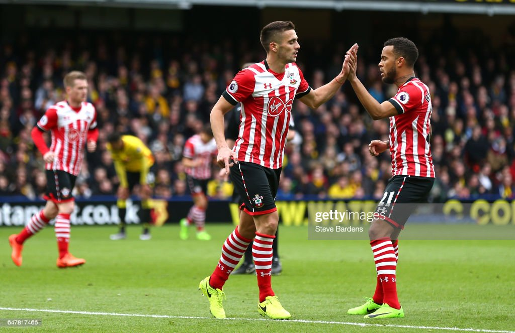 Dusan Tadic of Southampton (L) celebrates scoring his sides first goal with Ryan Bertrand of Southampton (R) during the Premier League match between Watford and Southampton at Vicarage Road on March 4, 2017 in Watford, England.
