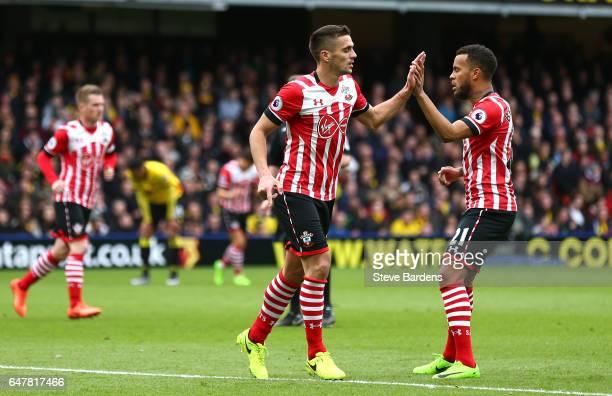 Dusan Tadic of Southampton celebrates scoring his sides first goal with Ryan Bertrand of Southampton during the Premier League match between Watford...