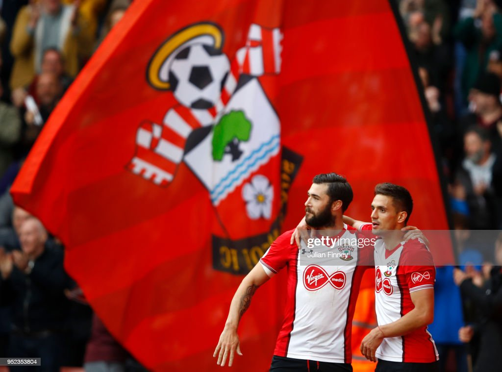 Dusan Tadic of Southampton celebrates scoring his side's first goal with Charlie Austin during the Premier League match between Southampton and AFC Bournemouth at St Mary's Stadium on April 28, 2018 in Southampton, England.