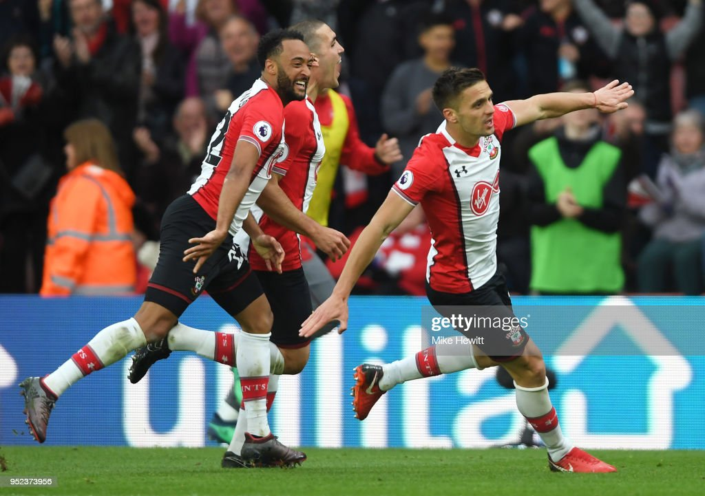 Dusan Tadic of Southampton celebrates scoring his side's second goal with Nathan Redmond and Oriol Romeu during the Premier League match between Southampton and AFC Bournemouth at St Mary's Stadium on April 28, 2018 in Southampton, England.