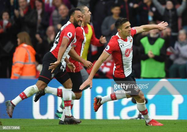 Dusan Tadic of Southampton celebrates scoring his side's second goal with Nathan Redmond and Oriol Romeu during the Premier League match between...