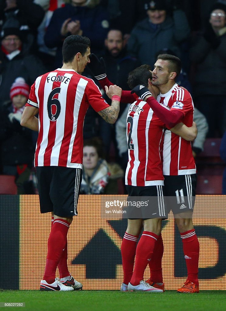Dusan Tadic (R) of Southampton celebrates scoring his team's third goal with his team mates Cedric Soares (C) and Jose Fonte (L) during the Barclays Premier League match between Southampton and West Bromwich Albion at St. Mary's Stadium on January 16, 2016 in Southampton, England.