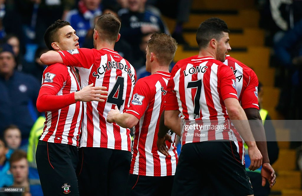 Dusan Tadic of Southampton (L) celebrates scoring their first goal with Morgan Schneiderlin and team mates during the Barclays Premier League match between Chelsea and Southampton at Stamford Bridge on March 15, 2015 in London, England.
