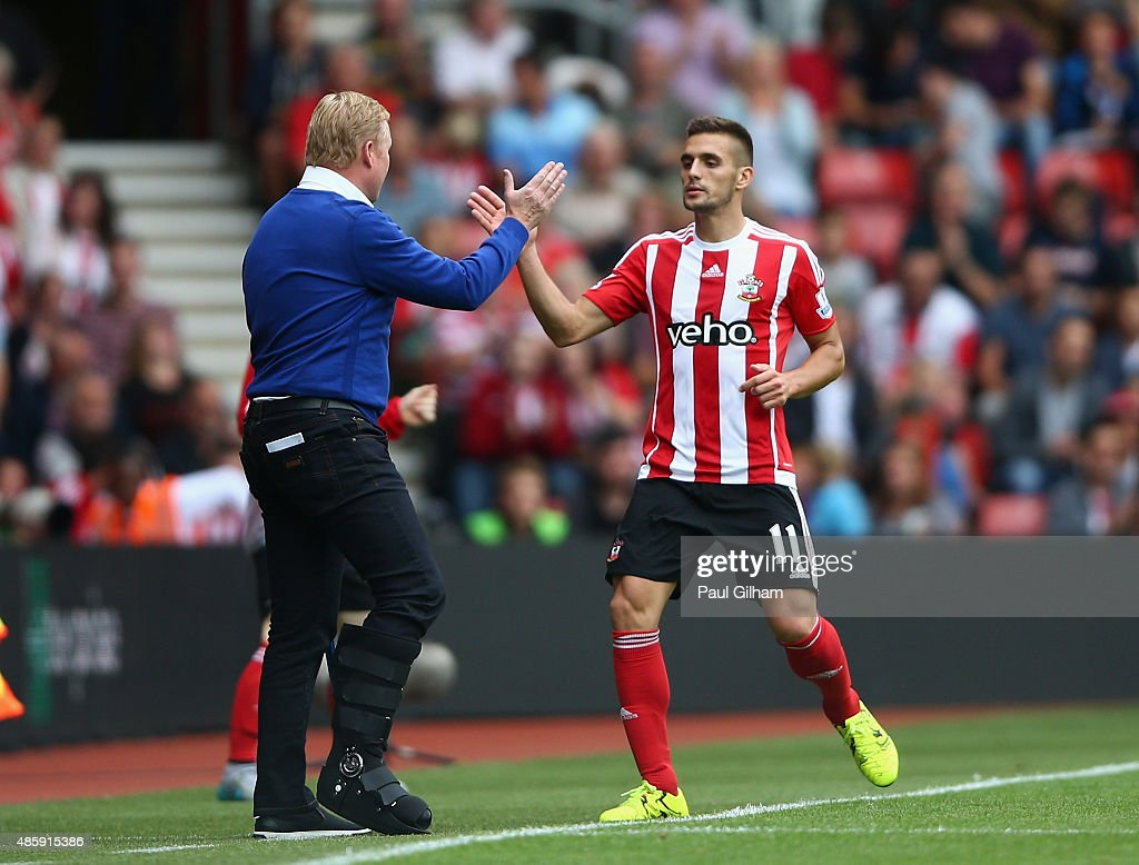 Dusan Tadic of Southampton celebrates with manager Ronald Koeman after scoring the second goal for Southampton during the Barclays Premier League match between Southampton and Norwich City on August 30, 2015 in Southampton, United Kingdom.