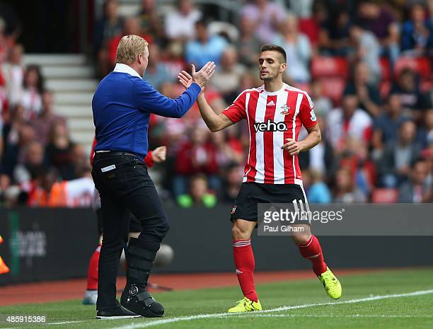 Dusan Tadic of Southampton celebrates with manager Ronald Koeman after scoring the second goal for Southampton during the Barclays Premier League...