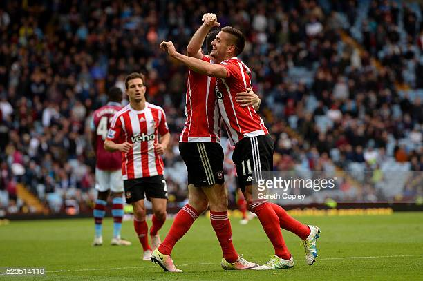 Dusan Tadic of Southampton celebrates with team mates after scoring his second goal during the Barclays Premier League match between Aston Villa and...