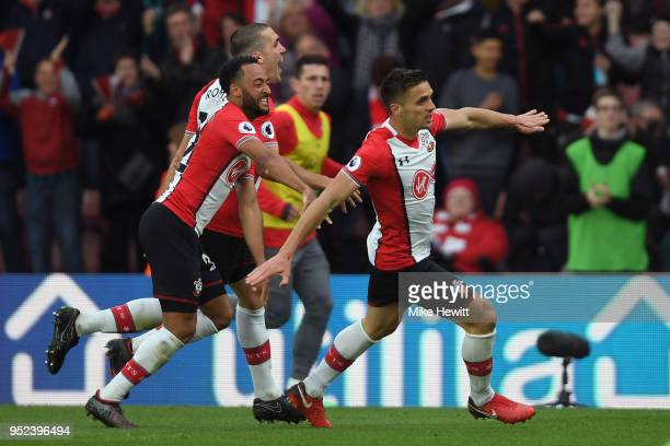 Dusan Tadic of Southampton celebrates with team mates Nathan Redmond and Oriol Romeu during the Premier League match between Southampton and AFC...