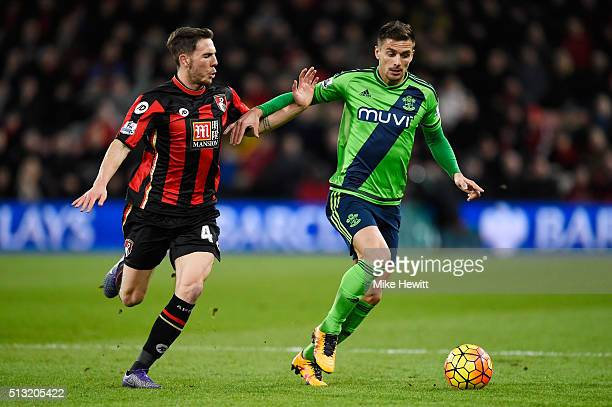 Dusan Tadic of Southampton controls the ball under pressure of Dan Gosling of Bournemouth during the Barclays Premier League match between AFC...