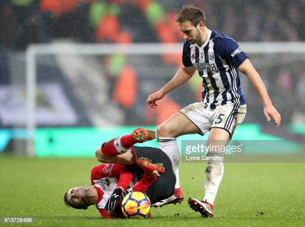 Dusan Tadic of Southampton goes down as Craig Dawson of West Bromwich Albion tackles during the Premier League match between West Bromwich Albion and...