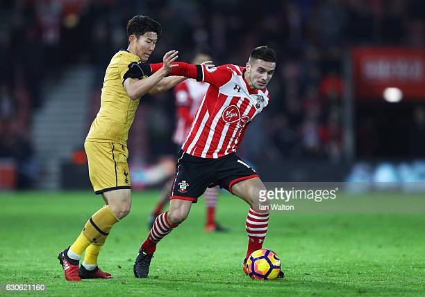 Dusan Tadic of Southampton holds off HeungMin Son of Tottenham Hotspur during the Premier League match between Southampton and Tottenham Hotspur at...