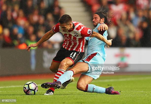 Dusan Tadic of Southampton is challenged by George Boyd of Burnley during the Premier League match between Southampton and Burnley at St Mary's...