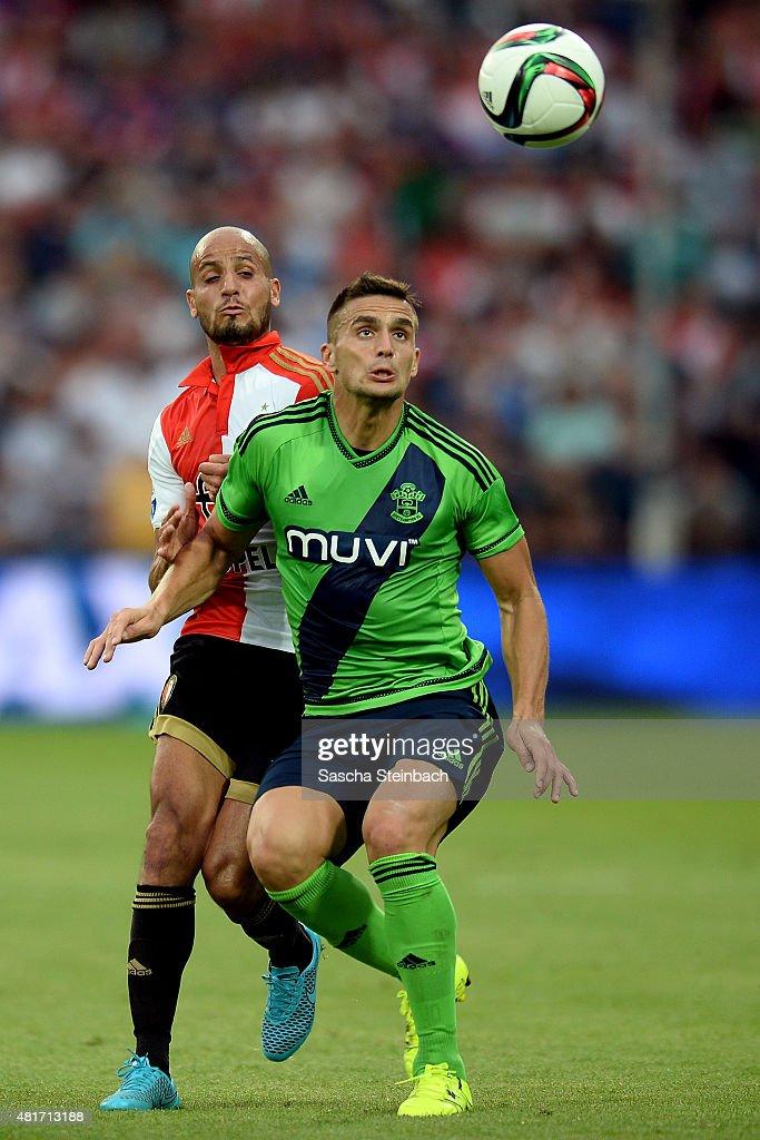 Dusan Tadic (R) of Southampton is challenged by Karim El Ahmadi (L) of Feyenoord during the pre season friendly match between Feyenoord Rotterdam and Southampton FC at De Kuip on July 23, 2015 in Rotterdam, Netherlands.