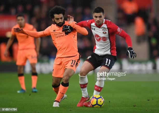 Dusan Tadic of Southampton is challenged by Mohamed Salah of Liverpool during the Premier League match between Southampton and Liverpool at St Mary's...