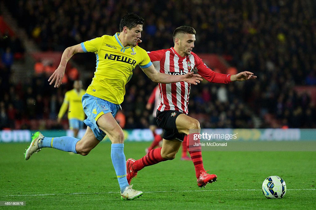 Dusan Tadic of Southampton is pursued by Martin Kelly of Crystal Palace during the Barclays Premier League match between Southampton and Crystal Palace at St Mary's Stadium on March 3, 2015 in Southampton, England.