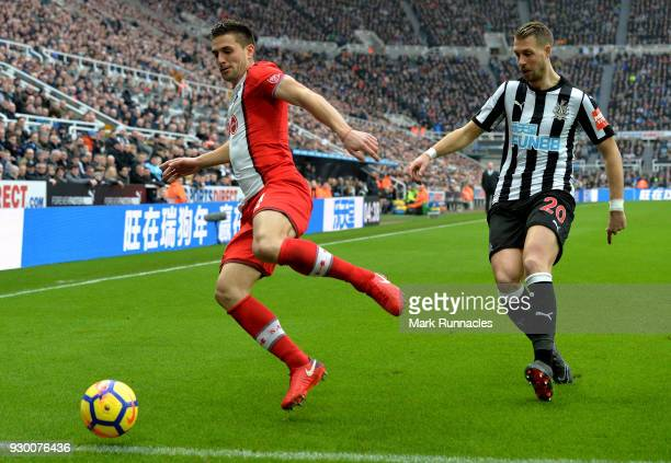 Dusan Tadic of Southampton is put under pressure by Florian Lejeune of Newcastle United during the Premier League match between Newcastle United and...