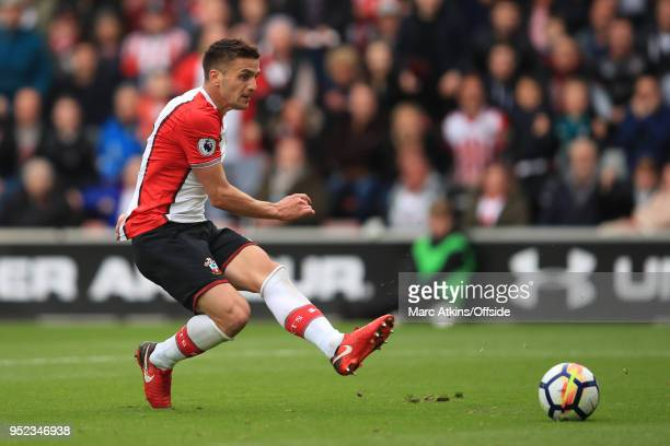 Dusan Tadic of Southampton scores the opening goal during the Premier League match between Southampton and AFC Bournemouth at St Mary's Stadium on...