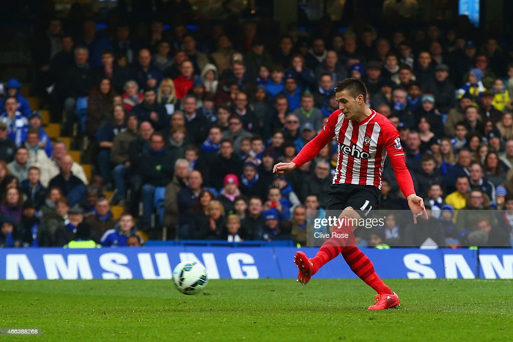 Dusan Tadic of Southampton scores their first goal from the penalty spot during the Barclays Premier League match between Chelsea and Southampton at Stamford Bridge on March 15, 2015 in London, England.