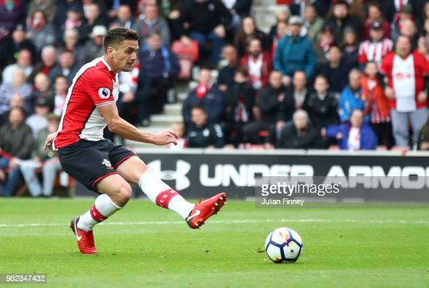 Dusan Tadic of Southampton shoots and scores his side's first goal during the Premier League match between Southampton and AFC Bournemouth at St...
