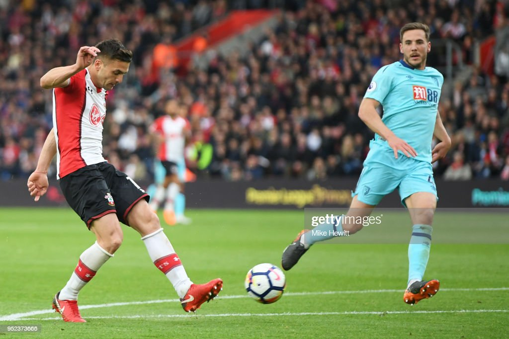 Dusan Tadic of Southampton shoots and scores his side's second goal during the Premier League match between Southampton and AFC Bournemouth at St Mary's Stadium on April 28, 2018 in Southampton, England.