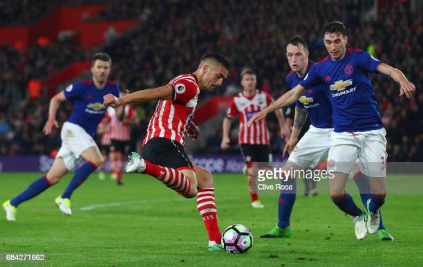 Dusan Tadic of Southampton shoots as Matteo Darmian of Manchester United attempts to block during the Premier League match between Southampton and...