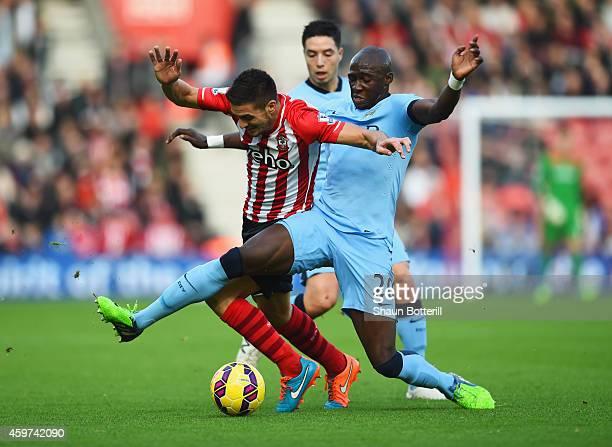 Dusan Tadic of Southampton takes on Samir Nasri and Eliaquim Mangala of Manchester City during the Barclays Premier League match between Southampton...
