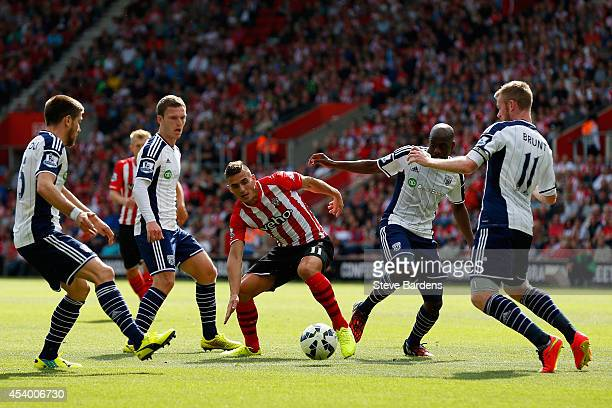 Dusan Tadic of Southampton tries to find a way through the West Brom defense during the Barclays Premier League match between Southampton and West...