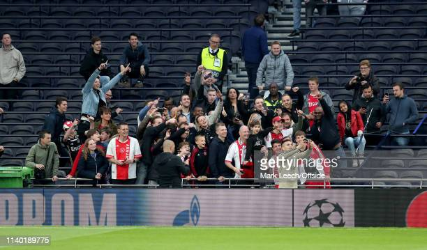 Dusan Tadic takes a selfie with delighted Ajax supporters at the Tottenham Hotspur stadium during AFC Ajax training at Tottenham Hotspur Stadium on...