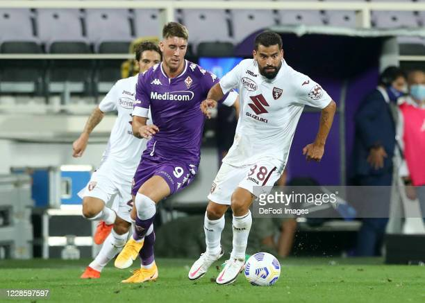 Dusan Vlahovic of ACF Fiorentina and Tomas Rincon of Torino FC battle for the ball during the Serie A match between ACF Fiorentina and Torino FC at...