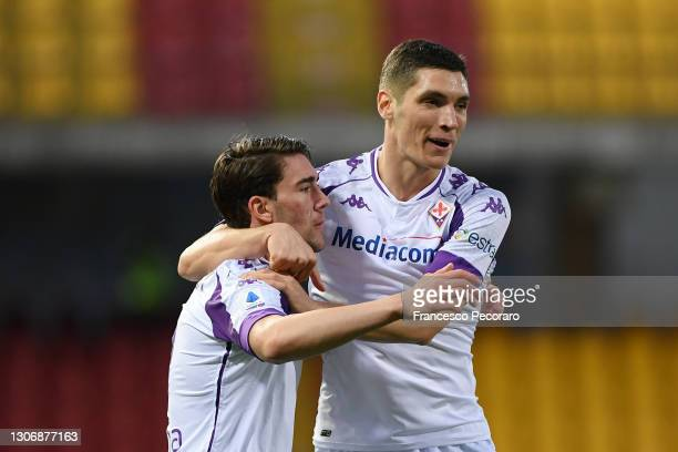 Dusan Vlahovic of ACF Fiorentina celebrates after scoring their team's first goal with teammate Nikola Milenkovic during the Serie A match between...