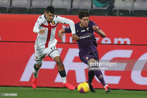 Dusan Vlahovic of ACF Fiorentina in action against Cristian Romero of Genoa CFC during the Serie A match between ACF Fiorentina and Genoa CFC at...