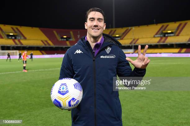 Dusan Vlahovic of AFC Fiorentina poses with the match ball after scoring a hat-trick during the Serie A match between Benevento Calcio and ACF...