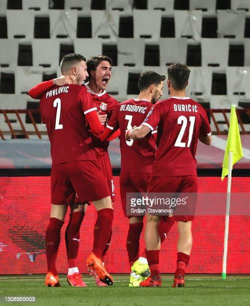 Dusan Vlahovic of Serbia celebrates after scoring his sides first goal with teammates Strahinja Pavlovic, Filip Mladenovic and Filip Duricic during...